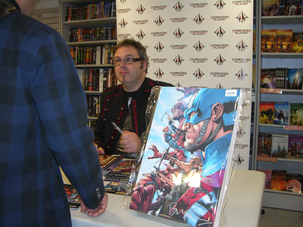 [World's Top Comic Artist, or Bryan to his mum, meets fans at FP.  ]
