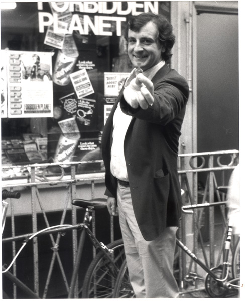 [Don't Panic! It's just Douglas Adams outside Forbidden Planet, Denmark St, 1980]