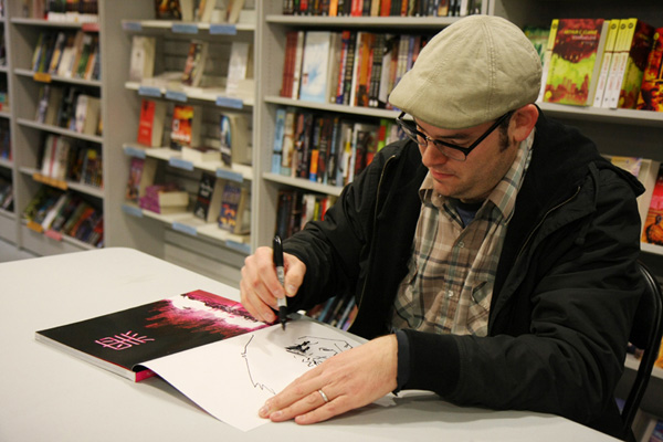 [Nathan Fox hard at work at Forbidden Planet  ]