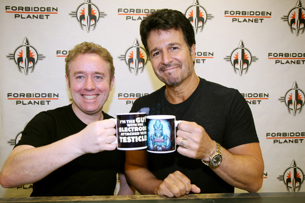 [Mark Millar and John Romita Jr. make a toast to Kick Ass ]